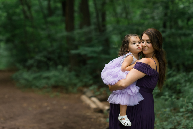 I was thrilled when Michelle from Pink Comb Studio reached out for her maternity photos. Following COVID-19 rule, keeping social distance I photographed Michelle and her two beautiful girls at Watchung Mountain NJ. With overcast weather three trees and grass showed such a rich deep green colors. I love bold rich colors in my photos as much as I love sunset golden hour. Michelle was just glowing and looked so beautiful. Was so happy to have such a beautiful mama in front of my camera before Michelle becomes mama of three girls. I can not wait to see her new baby girl and see her family grow. Michelle Surgent's maternity session captured by Karis from heykaris.