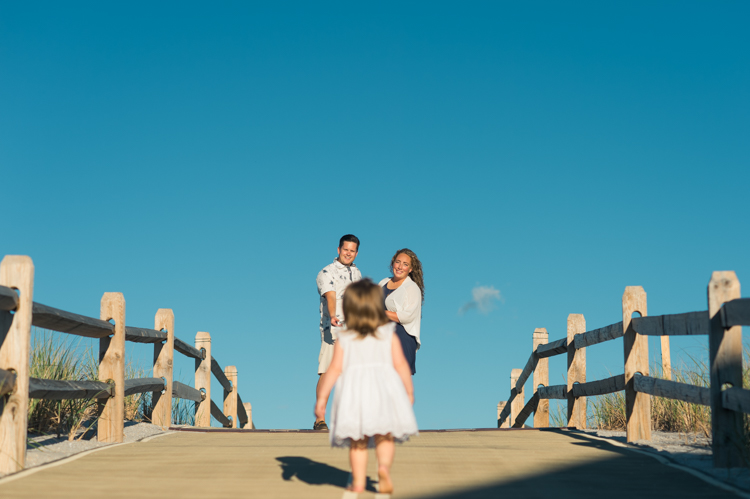 Sunset family session at Lavallette Beach NJ with my previous wedding couple Christina and JR. Christina and JR got married in 2017 at Molly Pitcher Inn in Red Bank NJ and now they have two charming daughters becoming family of four! It's always so good seeing old wedding clients with their growing family. Christina and JR's family session down Jersey Shore town Lavallette NJ was especially meaningful to them because it's where Christina and JR both grew up. The beach, sand, most amazing sunset is all very familiar to Christina and JR and it was so amazing photographing them with their two beautiful daughters. Christina, JR, Karlie and Maddy's family session photographed by Karis from HeyKaris.