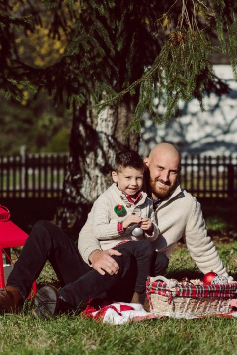 Brooke reached out to me for holiday family session and she had plans, props and we were all looking forward to Brooke and Mike's holiday family session with their two kids Grace and Tommy at Historic Richmond Town in Staten Island NY. Brooke and Mike are from Staten Island and they did not live too far from Historic Richmond Town and they decorate the whole town pretty festive so we decide to meet there. But like all plans Brooke's big hope for her very first professional photoshoot didn't go as she planed. Her two kids Grace and Tommy were not having it. As soon as they got to the parking lot Tommy fell asleep. Grace was shy and scared to have her photos taken by a stranger photographer me. But we tried and got some good cute photos, and some not so cute and grumpy photos as well. Brooke, Mike, Grace and Tommy's Historic Richmond Town Staten Island Holiday Family session documented and  photographed by Karis from Hey Karis. Photograph is like freezing time, motion in print, movie turned into a book. Now booking 2021 and 2022 weddings.
