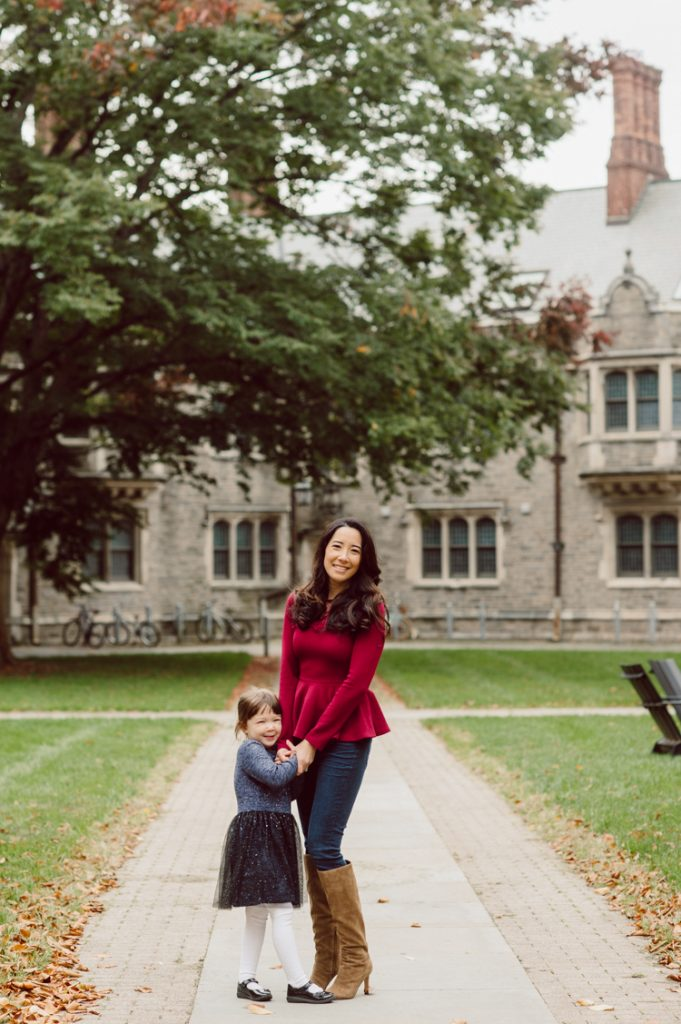 Windy morning spent at Princeton University Campus with Melissa, Joe, Everly and Cecilia. Everyone was bit cold and new to this family session but soon after how much fun and silly we can be during the photo session Everly warmed up, took her jacker off and ran. She ran, fell, hopped and would not stop posing for me. Till the moment we were ready to go home Everly posed, asked me to take more photos of her. Such a fun time with Bowen family during their family session at Princeton NJ photographed by Karis from Hey Karis. Photograph is like freezing time, motion in print, movie turned into a book. Now booking 2021 and 2022 weddings.